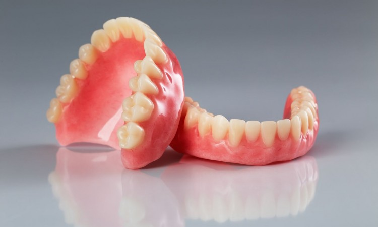 18545436 - a set of dentures on a shiny gray background