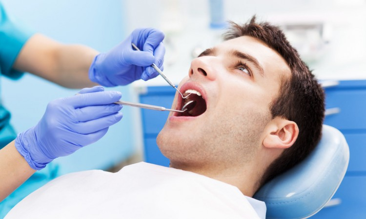 25126925 - man having teeth examined at dentists